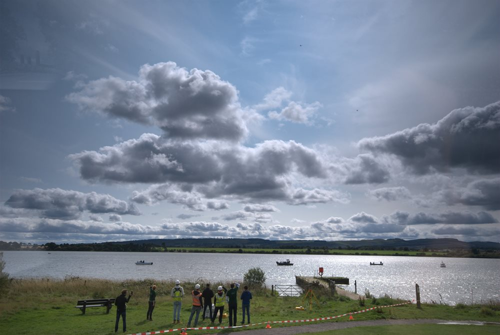 Loch Leven showing tiny drones in the sky